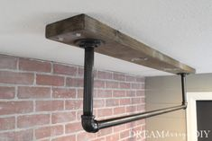 A ceiling mounted pull up bar is a perfect addition to a home gym. Here is a detailed tutorial to make your own. Here is what our home gym looked like when we moved into our house. We are slowly progressing through to get it to the final stage. Garage Pull Up Bar, Diy Pull Up Bar, Diy Bar, Homemade Pull Up Bar, Pull Bar, Home Gym Basement, Home Gym Garage, Gym Room At Home, Home Office