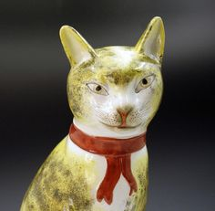 STAFFORDHIRE FIGURE OF A SEATED CAT
