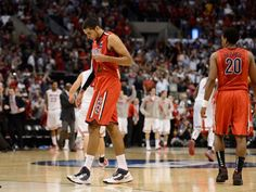 Arizona Wildcats forward Grant Jerrett (33, left) reacts after the semifinals of the West regional of the 2013 NCAA tournament against the Ohio State Buckeyes at the Staples Center. Ohio State defeated Arizona 73-70.