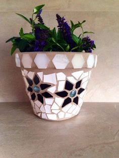 A personal favorite from my Etsy shop https://www.etsy.com/listing/291972213/mosaic-flower-pot-rustic-outdoor-planter