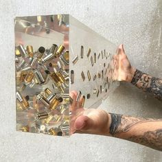 Shreds are the pieces of guns that remain after they have been, either, voluntarily turned in through gun buy back and amnesty programs or seized from crime sce Epoxy Resin Table, Epoxy Resin Art, Diy Resin Art, Diy Resin Crafts, Wood Resin, Diy Art, Resin Furniture, Clear Ornaments, Recycled Art