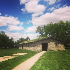 Fort Kearney State Park in Kearney, NE. This is a reconstructed stockade -- the outlines of the original foundations of the fort buildings are still extant. We found it most impressive for its enormous mature trees -- many originally planted while the fort was still in commission.