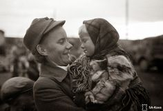 Finnish Lotta with a Finnish child being evacuated from Enare via Rovaniemi, 1944. - Finland