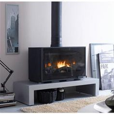 This could be a nice compromise to replacing an open fire. Home Fireplace, New Homes, Deco, Stove, Retractable Glass Doors, Freestanding Fireplace, Modern Rustic, Modern Wood, Wood Stove