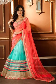 Beautiful lehenga choli in net material - Stand out from rest with this peach and blue color lehenga choli. It is crafted on net material. Front and back side choli is embellished with stone; katdana and zardosi work in lovely pattern. Fan lace and stylish lace borders engraved at the bottom of the lehenga. Scattered buttis on dupatta with four side lace border looks awesome.