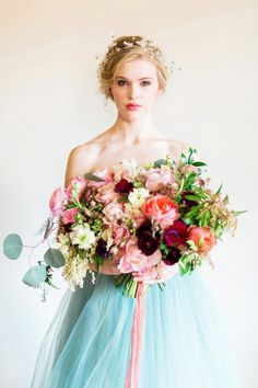 Colorful Bridal Bouquet with a Blue Wedding Dress | Rustic White Photography | http://heyweddinglady.com/colorful-modern-fairy-tale-bridal-shoot/