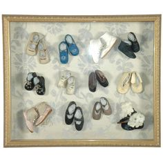 A collection of Victorian and Edwardian baby shoes, now mounted and framed. View 1