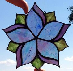 This Sun Catcher has been adopted already. If you like that pattern, I can make it in a variety of colors. Just send me a message and I will custom make one for you. sweveneers@gmail.com