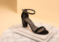 Delicate and crafted in soft velvet, these Stuart Weitzman block heeledsandals are the perfect cushion for the most stylish feet.  #STUARTWEITZMAN #SANDALS #SHOES #HEELEDSANDALS