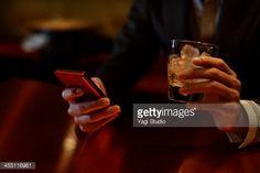 ストックフォト : Man using smart phone in the bar Kyoto, Smartphone, Japan, Okinawa Japan