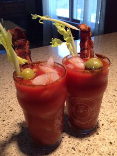 Best Bloody Mary EVER! Clamato, V8, Sting Ray mix, olive juice, garlic pwd, Worcestershire, chipotle Cholula, Double smoked bacon, celery - and to finish it off: homemade stuffed olives with blue cheese, garlic paste and jalapeño!!