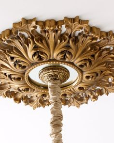 """""""Rococo"""" Mirrored Ceiling Medallion - This ceiling medallion enhances the glow of your chandelier even more as light reflects off the mirrored panel and mingles with the warm antique-gold finish of its intricate design. Handcrafted of molded resin. 25""""Dia. x 2.25""""T with .5"""" center hole. Made in the USA"""