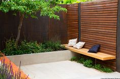 A floating timber bench overhangs from the trellis, whilst some underplanting break up the concrete with lush foliages. Some corten strips incorporated in the wall add some repetition, echoing the corten steel wall behind the tree. Modern Backyard, Modern Landscaping, Backyard Landscaping, Backyard Ideas, Modern Landscape Design, Garden Landscape Design, Home Garden Design, Patio Design, Ideas Terraza