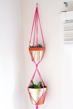 DIY hanging neon and gold planters at Holly Would -- replace plastic plant hangers Gold Planter, Diy Hanging Planter, Hanging Planters, Fence Planters, Diys, Macrame Projects, Diy Projects To Try, Plant Hanger, Decoration