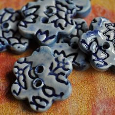Lucy Fagella's buttons could get me knitting. Or asking for someone to knit for me! http://www.etsy.com/listing/88249876/colorful-buttons-set-of-three#