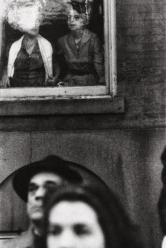 """Saul Leiter: """"MacArthur Parade, c. 1951."""