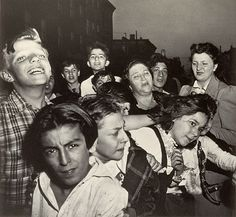 """Their First Murder    Weegee (aka Arthur Fellig)     """"A woman relative cried...but neighbourhood dead-end kids enjoyed the show when a small-time racketeer was shot and killed,"""" wrote Weegee in the caption accompanying this startling photograph in his 1945 publication Naked City."""