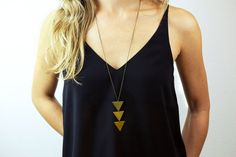 Triangle necklace: arrow necklace, NEFERTITI NECKLACE is a simple long necklace with a stack of three raw brass triangles. Long necklaces are