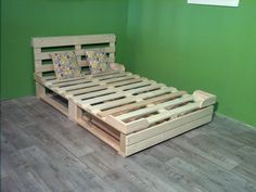 DIY pallet platform bed with headboard and drawer