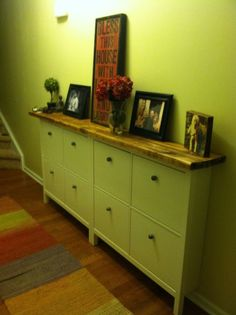 LOVE the wooden top. Hemnes IKEA hack- shoe holders for front hall.