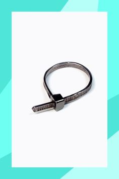 24 Unique Stacking Rings That Make Serious Statements #refinery29  http://www.refinery29.com/stacking-rings#slide-8  This zip-tie ring gives your stack the ultimate edge....