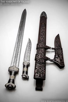 *I Love This!* The Vigrid by Andre Andersson Blade sword:3 bar mosaic damascus. Blade knife:5 bar mosaic damascus. Steels:Uddeholm 15N20 and 15LM. Handle:Ebony, damascus steel and 925 etched silver. Sheath:Ornamented rawhide leather sheaths. Total length sword: 83cm (32.677 inch), Weight without sheath 1.45kg (3.196 pund) Total length knife: 37cm (14.566 inch), weight 0,75kg