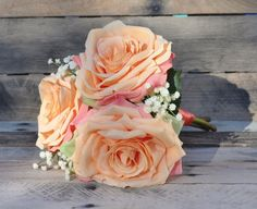 Peach and cream bouquet with a touch of coral ribbon on the stems.  Photography by Adair Design Haus adairdesignhaus.com See more here: https://www.etsy.com/listing/270552659/silk-wedding-bouquet-bridesmaid-bouquet