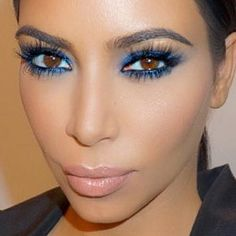 Kim Kardashian had a bright blue makeup that really made her eye pop; makeup by Celebrity MUA Mario Dedivanivic