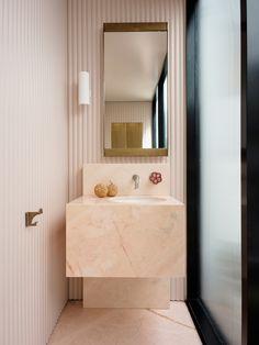 bathroom by Flack Studio with brass and peach-hued marble #hellopeagreenspots #bathroom #interiordesign