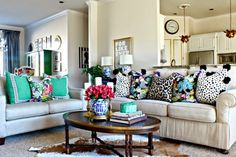 Notice AMAZING floral antique gold lamps in open floor plan, as well as BRIGHT green display (china) cabinet in back! Also: Throw pillows of all shapes, sizes, and color!