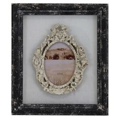 Wood picture frame with a warmly weathered finish.Product: Picture frameConstruction Material: Wood and metal...