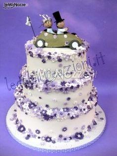 http://www.lemienozze.it/operatori-matrimonio/catering_e_torte_nuziali/le_dolci_creazioni/media/foto/3  Torta nuziale con fiori lilla e cake topper sposini