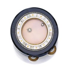 GOLD, DIAMOND, ONYX AND ENAMEL 'COMET' 8-DAYS CLOCK, CARTIER The round clock with a revolving pale salmon-colored enamel dial over a guilloc...