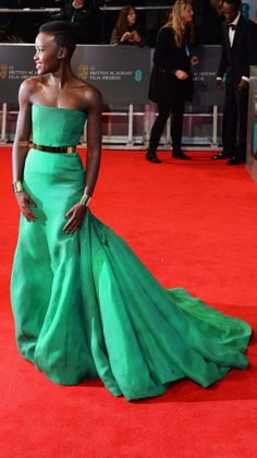 Lupita Nyong'o at the BAFTA Awards in an  emerald green Dior Haute Couture gown Purely Inspiration