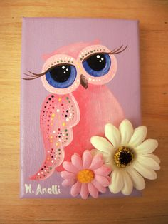 Owl with Big Eyes. A lovely hand painted owl made with care and detail on a 100% cotton canvas! This charming artwork is an original and unique piece (NOT A PRINT), created with fine quality acrylic paints, mostly in purple, pink, white and blue, and then embellished with two flowers. A lovely example of owl art, perfect as wall decor for girls' bedrooms. This owl painting makes a great present and a last minute gift idea for little girls and teenagers.
