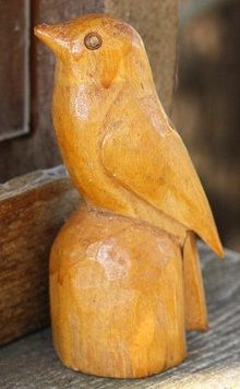 carved wood bird