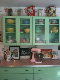 Fire-King green cabinets, pink stand mixer, linoleum counters - cute vintage!