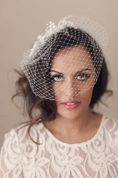 Add instant vintage elegance with a gathered net birdcage veil, make it contemporary and unique with your choice of comb, headband or hair pin. Photographed here with Ophelie Comb, order this or another accessory separately.  Sewn and pressed to keep an elegant curve across the face or head.  A versatile bridal headpiece. www.mimosabridal.com