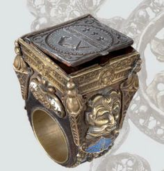 A beautiful luxury ring of it's time with a secret compartment and gorgeous engraving's, Europe, circa 1600.
