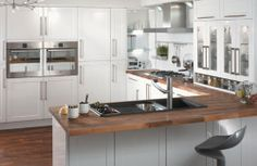 Double ovens at chest height, we love 'em. Practical, look good, and plenty of space for the Sunday roast