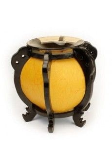 """Asian style oil warmer measures 7"""" tall, 7.5"""" diameter. Orange cylinder with bronze tinted dish for the oil. Uses one 35 watt halogen bulb (included)."""
