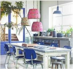 I think this is a fabulous kitchen/dining. love the blue french doors and the light fixtures are so fun