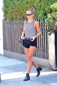 Nicole Richie in a striped tank, black shorts, and black ankle boots