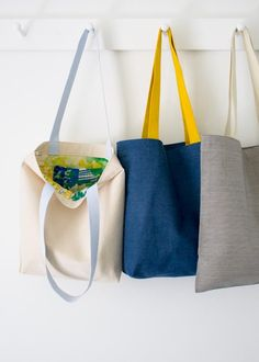 These look easy enough to whip up as library bags for the sunmer, but nice enough to give as gifts.