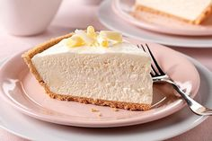 A filling of cream cheese, white chocolate flavor pudding and whipped topping is spooned into a graham cracker crust in this airy, no-bake cheesecake.