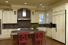 Custom Kithcen with a mix of wood stain and painted cabinets.