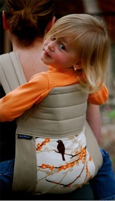 @Laura BabyHawk Baby Carrier.., works for big kids too!! We could ale it now and you could use it for Hazel!