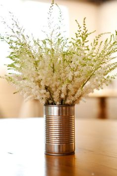 For some reason I like the tin can as a vase!