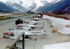 Swiss De Havilland Vampire jets get refueled at an airfield