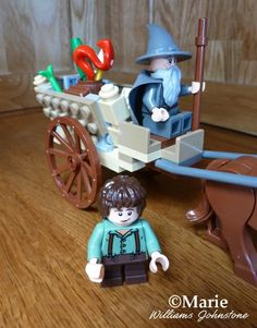 Gandalf Arrives Lego - see the red dragon firework in the back of the cart, ready to set off at Bilbo's 111st birthday